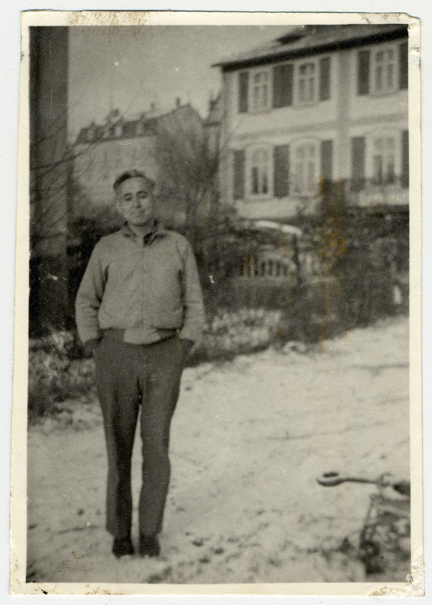 War crimes investigator, Isidor Reece stands outside a building.  Isidore Reece, an American Jewish soldier was the sponsor of Shmuel Shalkovsky (donor).  He brought the latter onto the war crimes team and got him a visa to come to America.