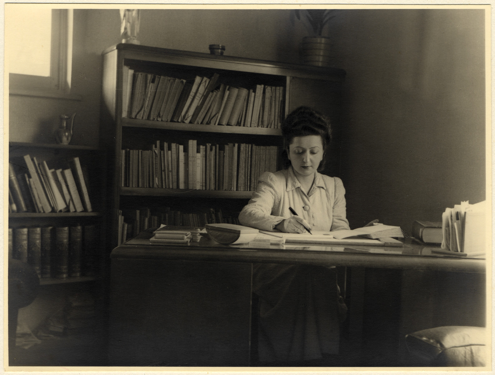 Jewish rescuer, Fela Perelman, works at her desk.