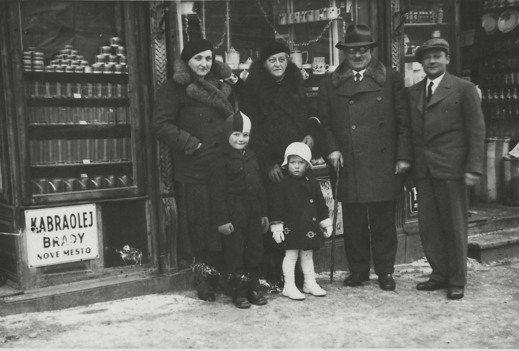 The Brady family stands outside their store in Nove Mesto.