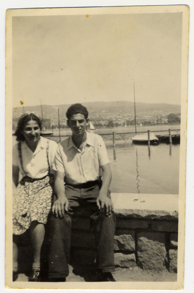 Tauba and David Suesskind, relax next to a lake in Zurich soon after they managed to cross the Swiss border.