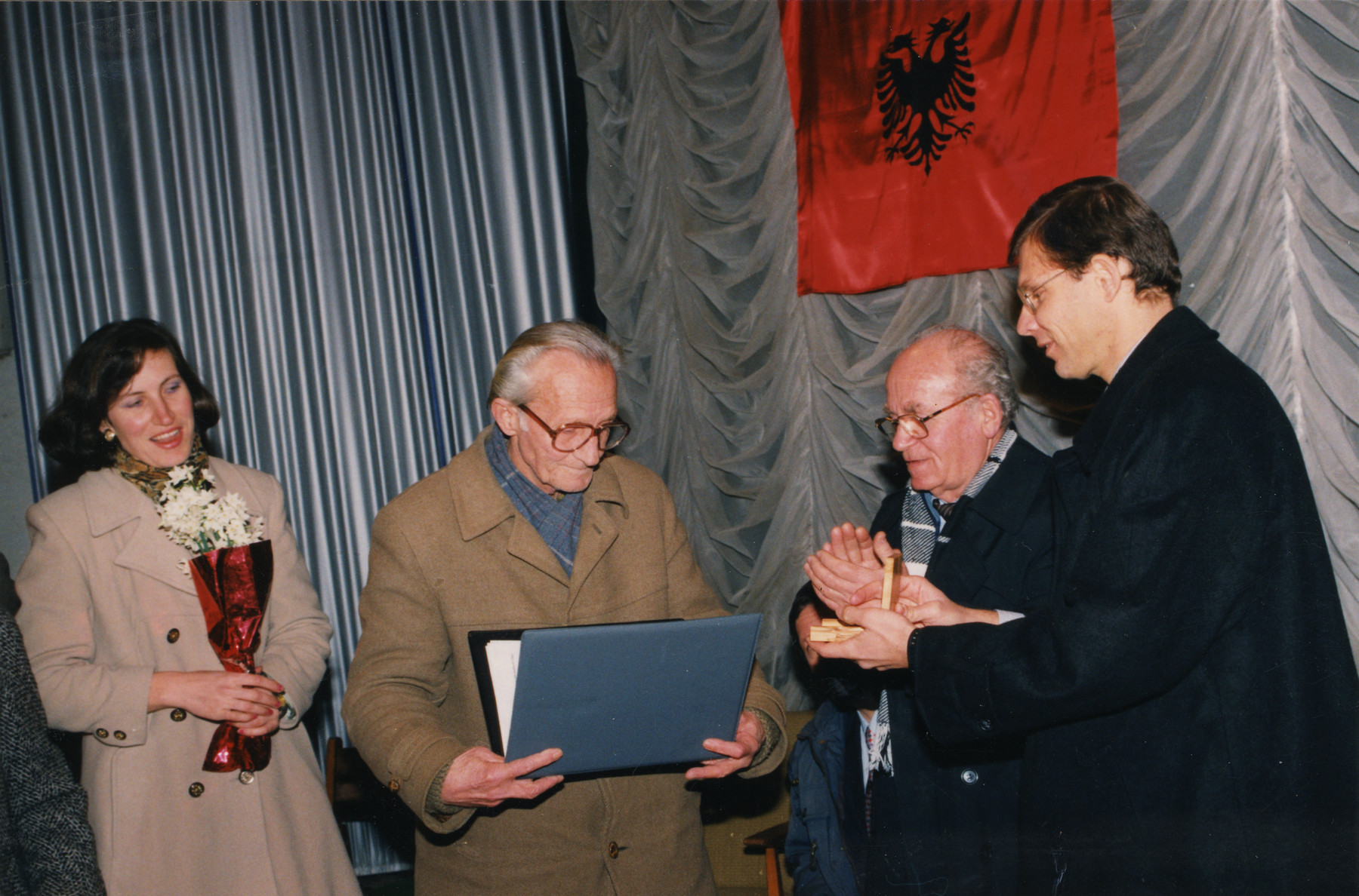 Edip Pilku accepts the Righteous Among the Nations award on behalf of his parents, rescuers, Njazi and Lisa Lotte Pilku.  Also pictured is another Albanian rescuer, Refik Veseli (second from the right) and the Israeli Ambassador, Tibor Schlosser (far right).  The daughter of Edip Pilku is standing on the far left.