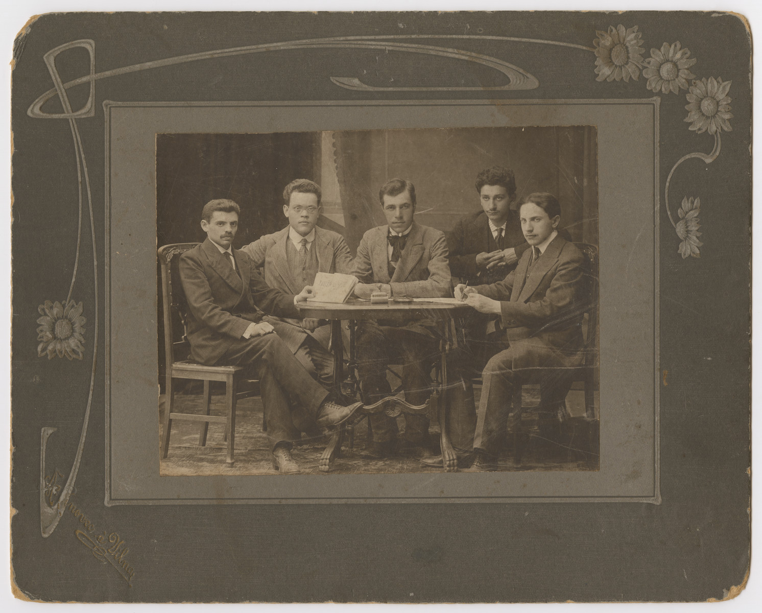 Studio portrait of the staff of a Zionist newspaper in Vilna.  Abraham Reiches is pictured second from the left.