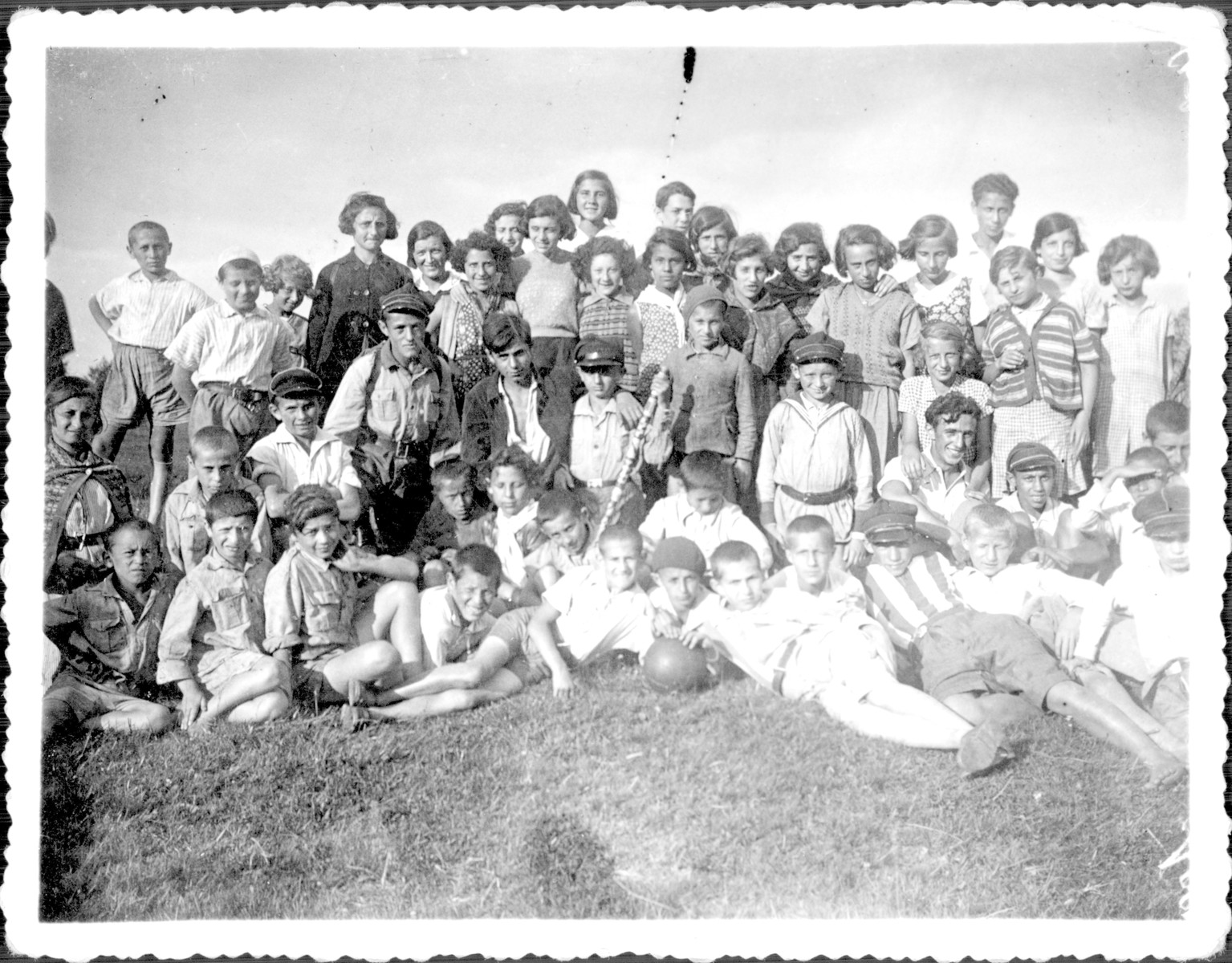 Members of Hashomer Hatzair from the Korczak Orphanage go a Lag B'omer outing.  Shlomo Nadel is pictured on the far right with a hat.