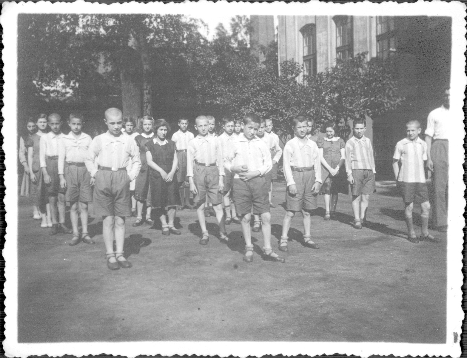 Children line up for morning gymnastics on the grounds of the Korczak orphanage.