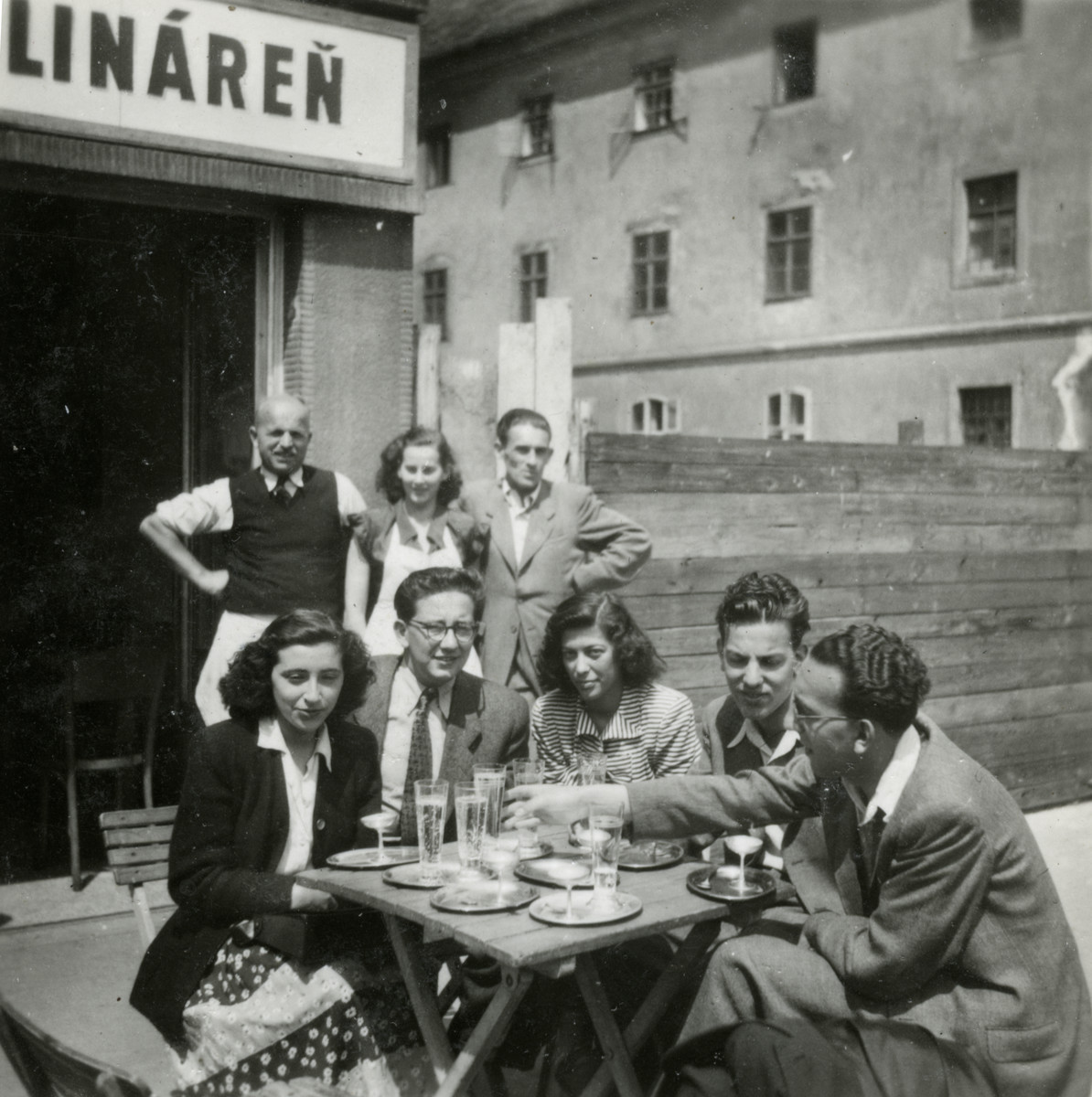 A group of friends from the Zionist youth group Gordonia stop at a cafe in Bratislava, on their way to Israel.  Pictured seated on the right are Zvi and Itzhak Braf.