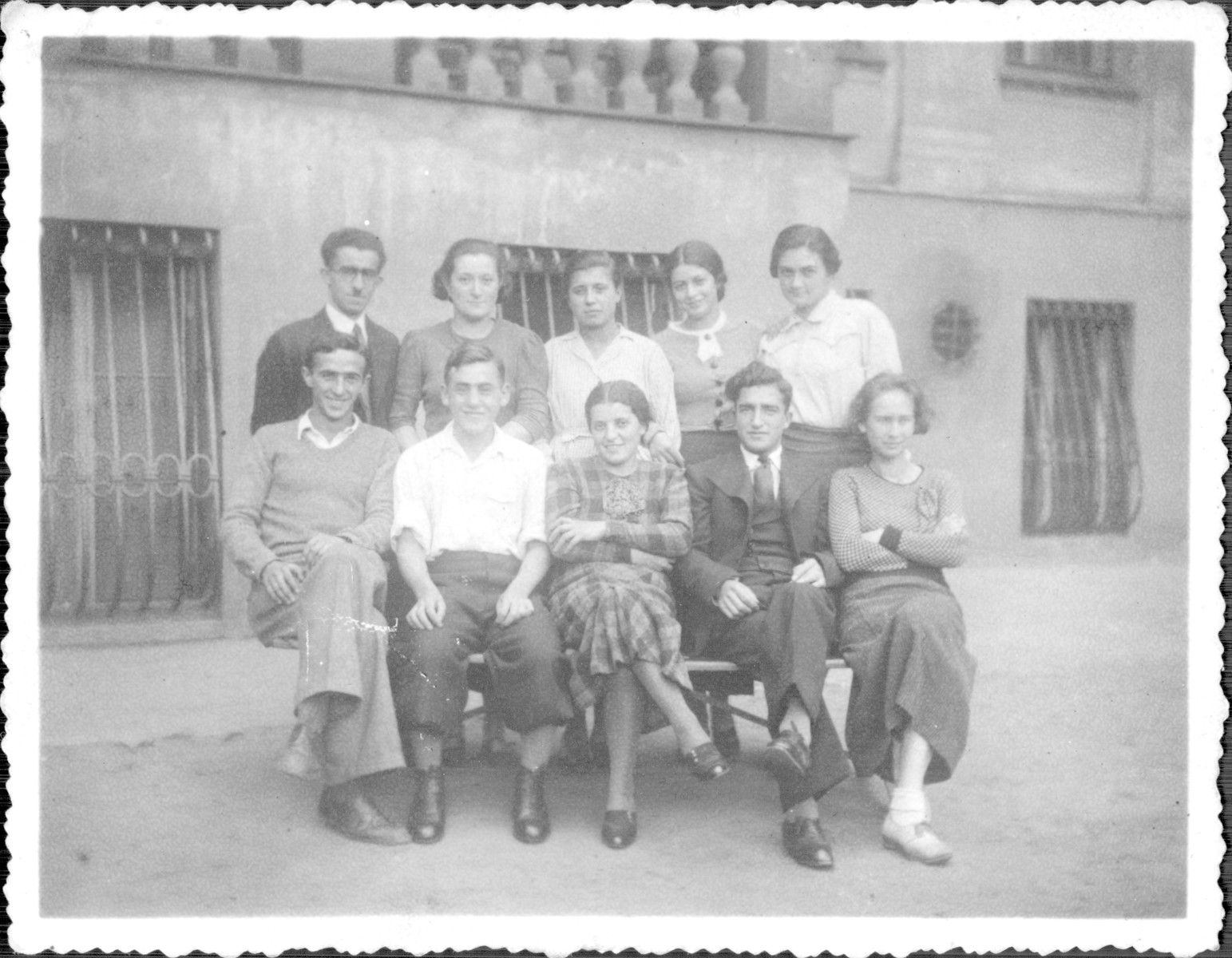 Group portrait of student teachers at the Korczak Orphanage.  All were education students who worked in the orphanage four hours a day. Among those pictured are Felix Gyp (first row, far left) and his fiance (second row, middle). They perished with the orphanage during the Holocaust.
