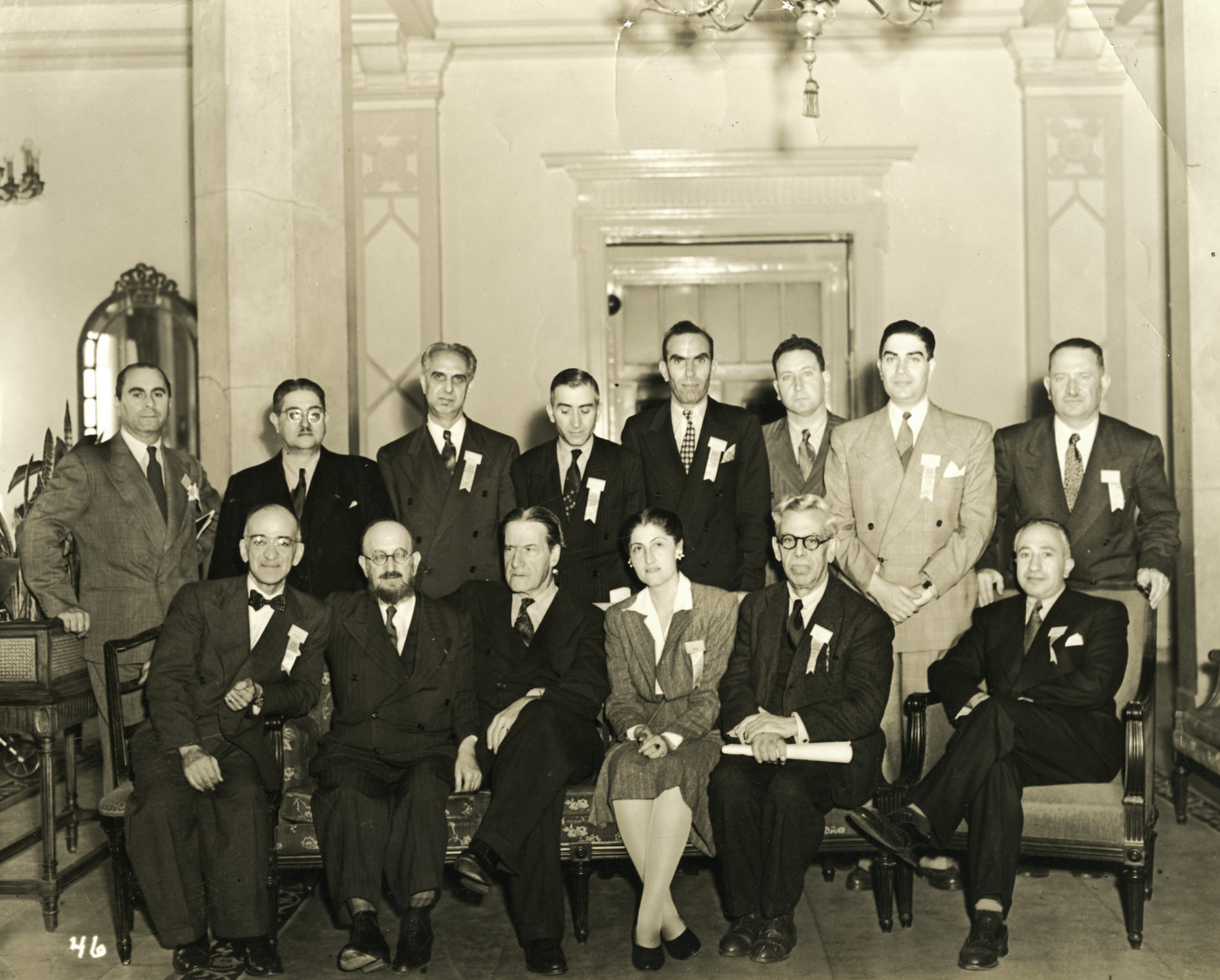 Group portrait of the North African delegation to the 1944 War Emergency Conference of the World Jewish Congress.   Prosper Cohen is pictured standing fourth from the right, top row. Also pictured is Rabbi Stephen Wise, seated third from the left.