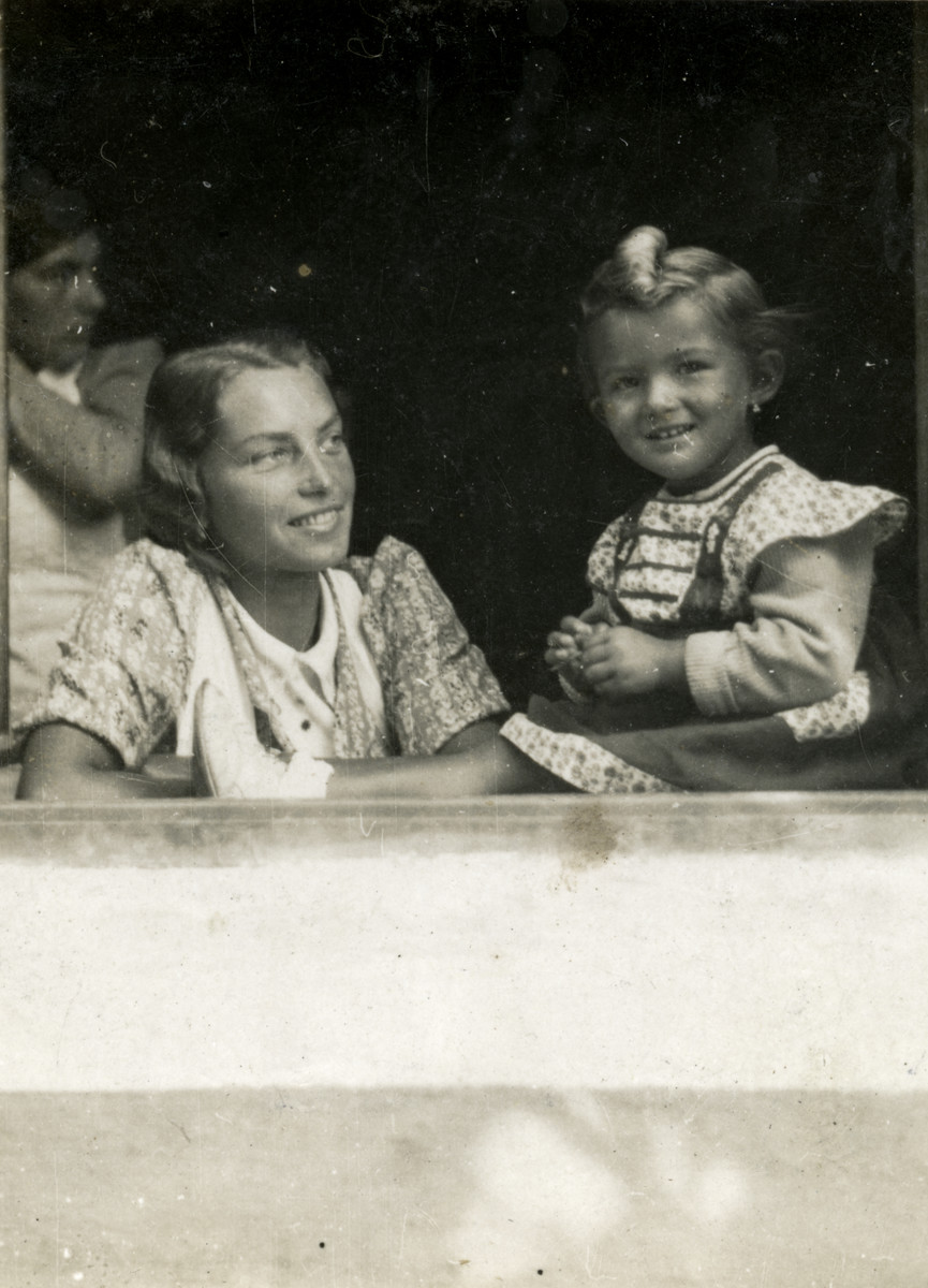 Close-up portrait of a Jewish child with her governess.  Pictured on the right is Erica Deitelbaum (cousin of donor), who perished in the Holocaust.