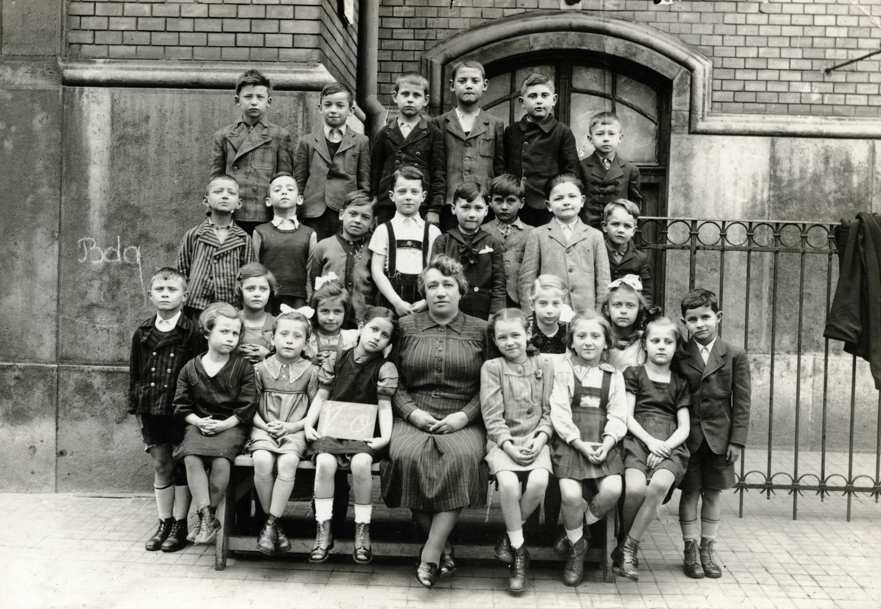 Class portrait of a first grade class in Budapest.  Judith Schonfeld is pictured in the second row, second from the right.