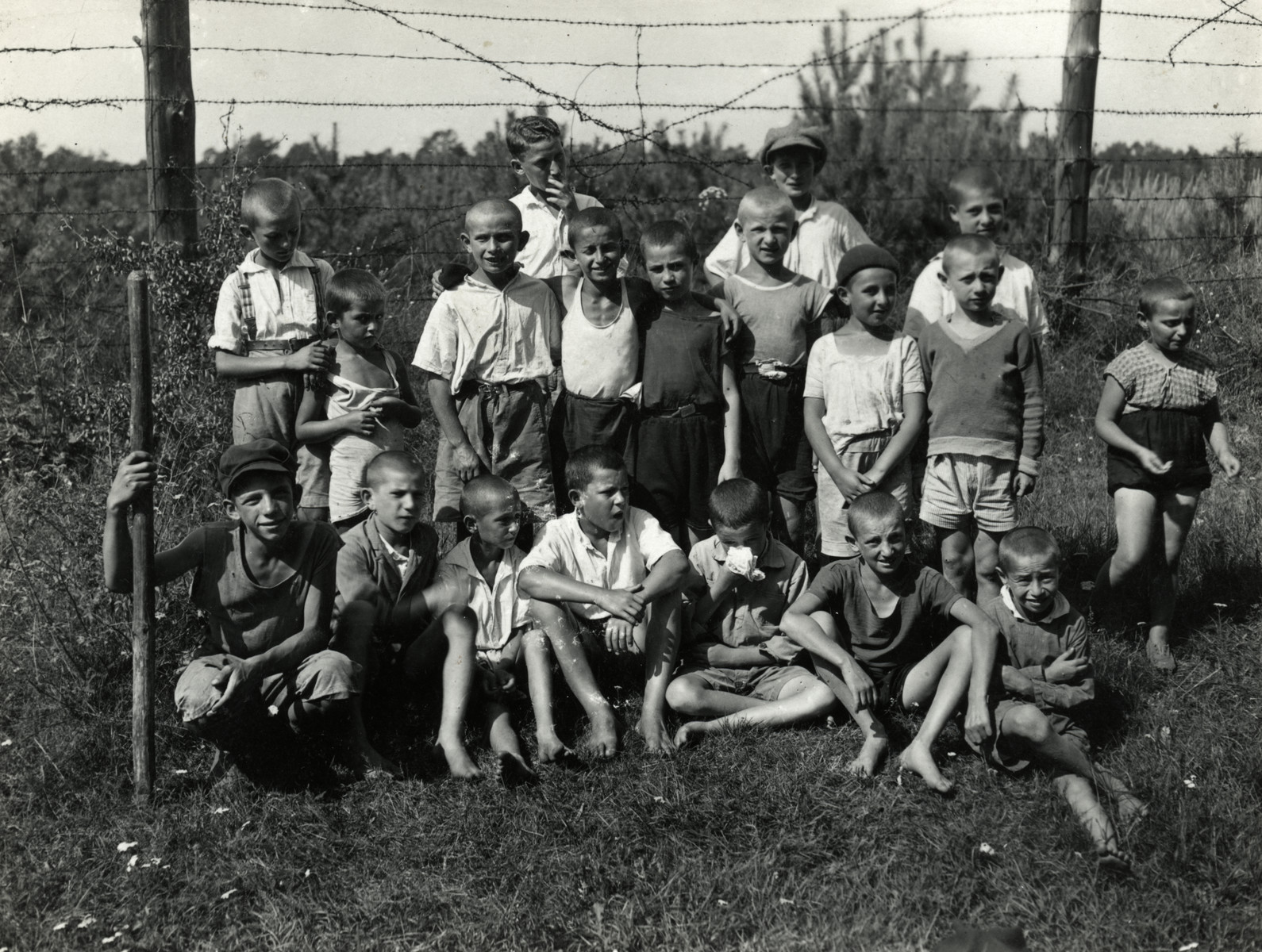 Boys from Korczak's orphanage pose outside on a field.