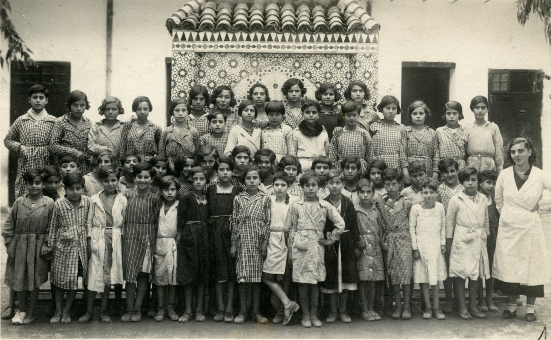 Laurette Cohen (front row, in the far right) poses with her students at an Alliance Israelite School in Morocco.