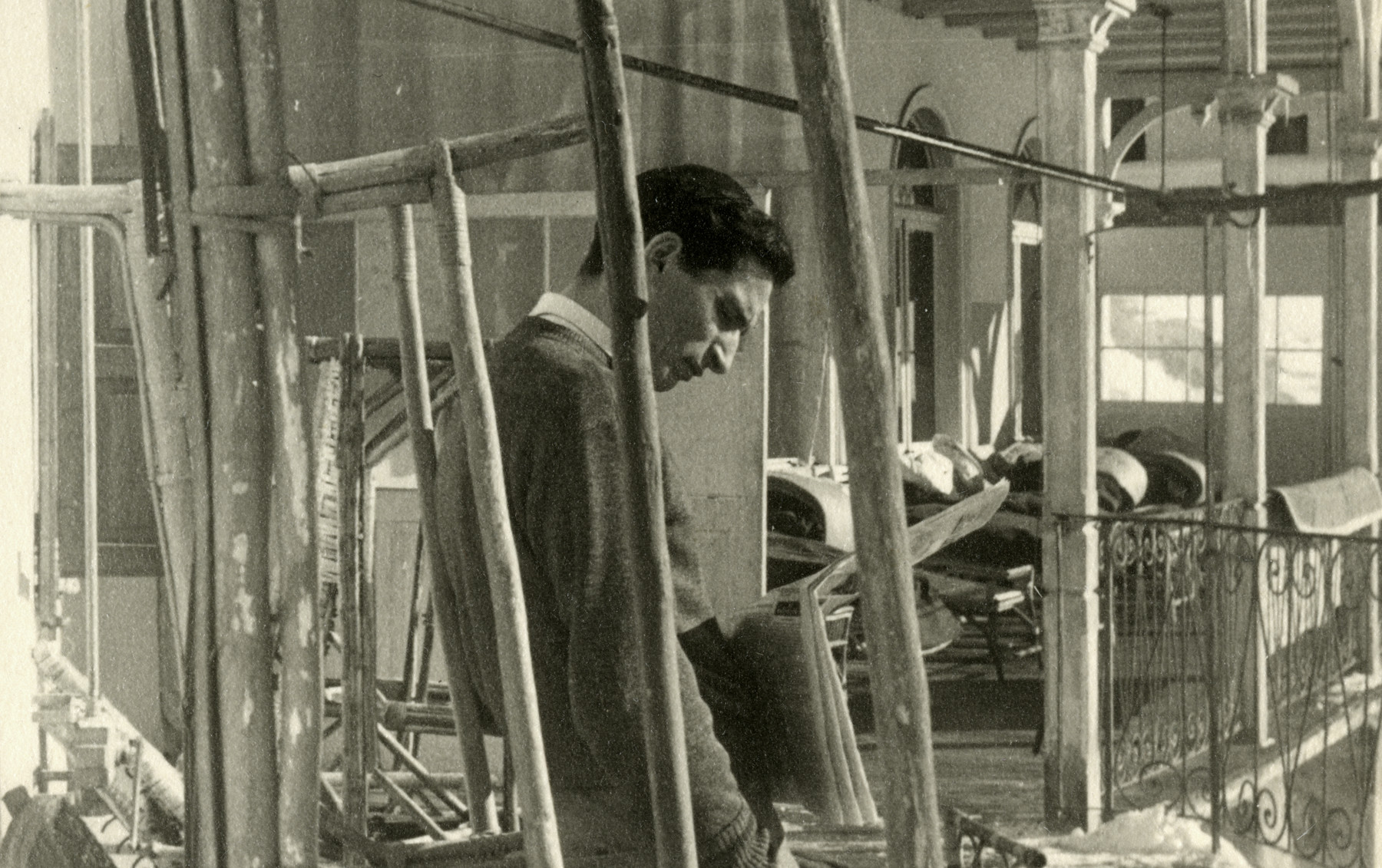 Zvi Grundman stands next to wooden chairs for sun care in the Beit Havraah sanatorium in Davos.