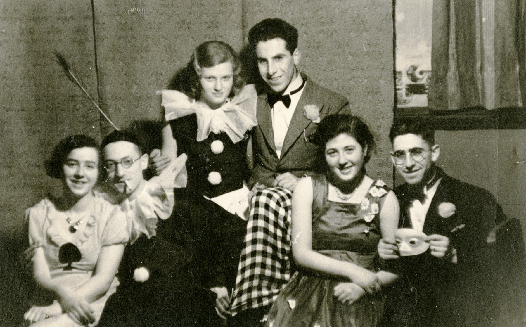 Three young Dutch Jewish couples celebrate Purim in prewar Holland.  Pictured are Ammy and Nico Herschel (left), Ammy's sister Bilha and her husband, Aaron Davidon (center), and unidentified friends.  Aaron Davidson perished during the war.