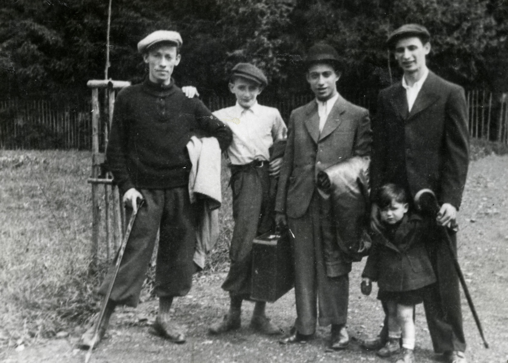 Zvi poses with his friends at a resort near Katowice at a Noar Dati religious summer camp.  Zvi Grundman is pictured first from the right.  Shmuel Joseph is pictured third from the right.