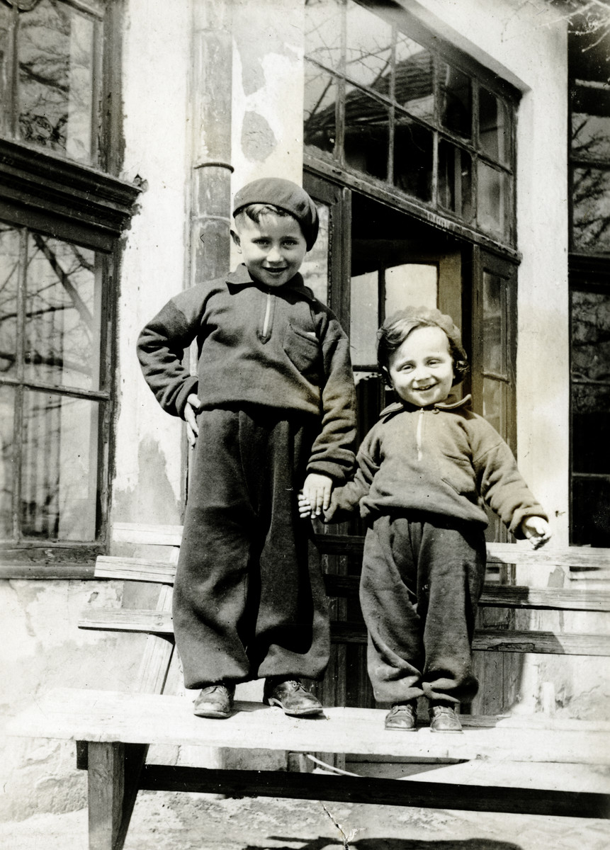 Two young Jewish Schonfeld brothers pose on the steps of a building in Satoraljaujhely.  The boys (Pauly pictured on the right) were cousins of the donor.  Both perished about four years later in Auschwitz.