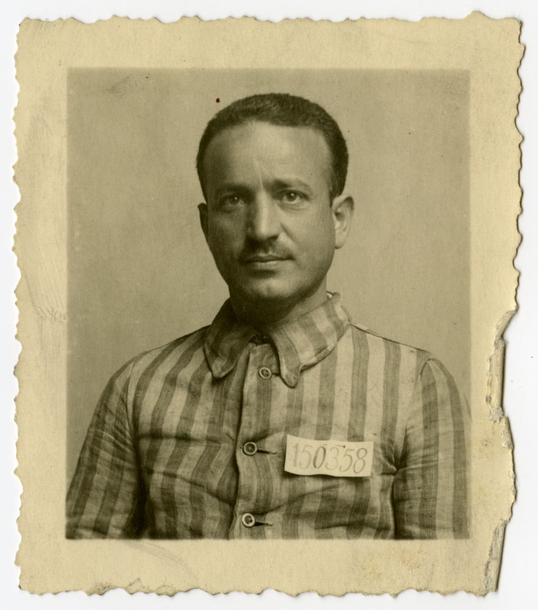 Moses Rontal poses in his former camp uniform some time after liberation.