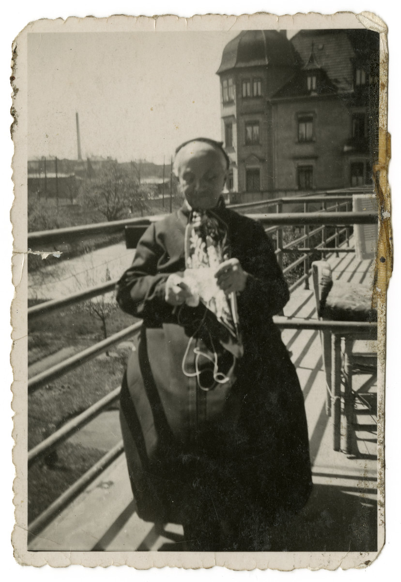 Johanna Sternheimer Juengster knits on the porch of an old age home about a year before her death.
