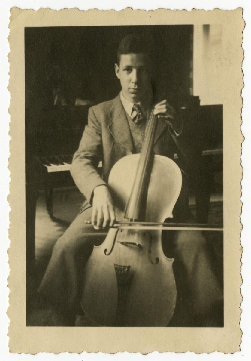 Norbert Mueller practices cello in his home in Nuremberg