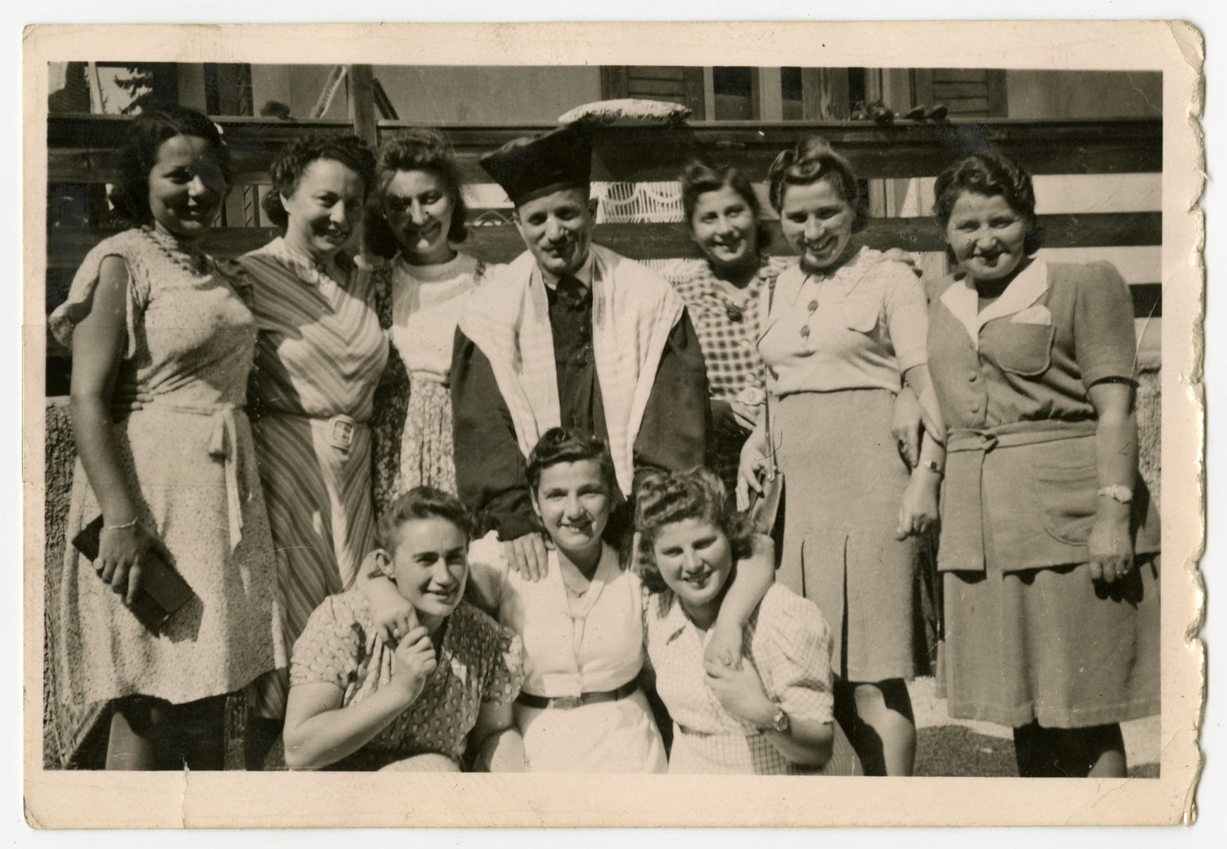 Cantor Moses Rontal poses with female displaced persons [probably in Stuttgart].