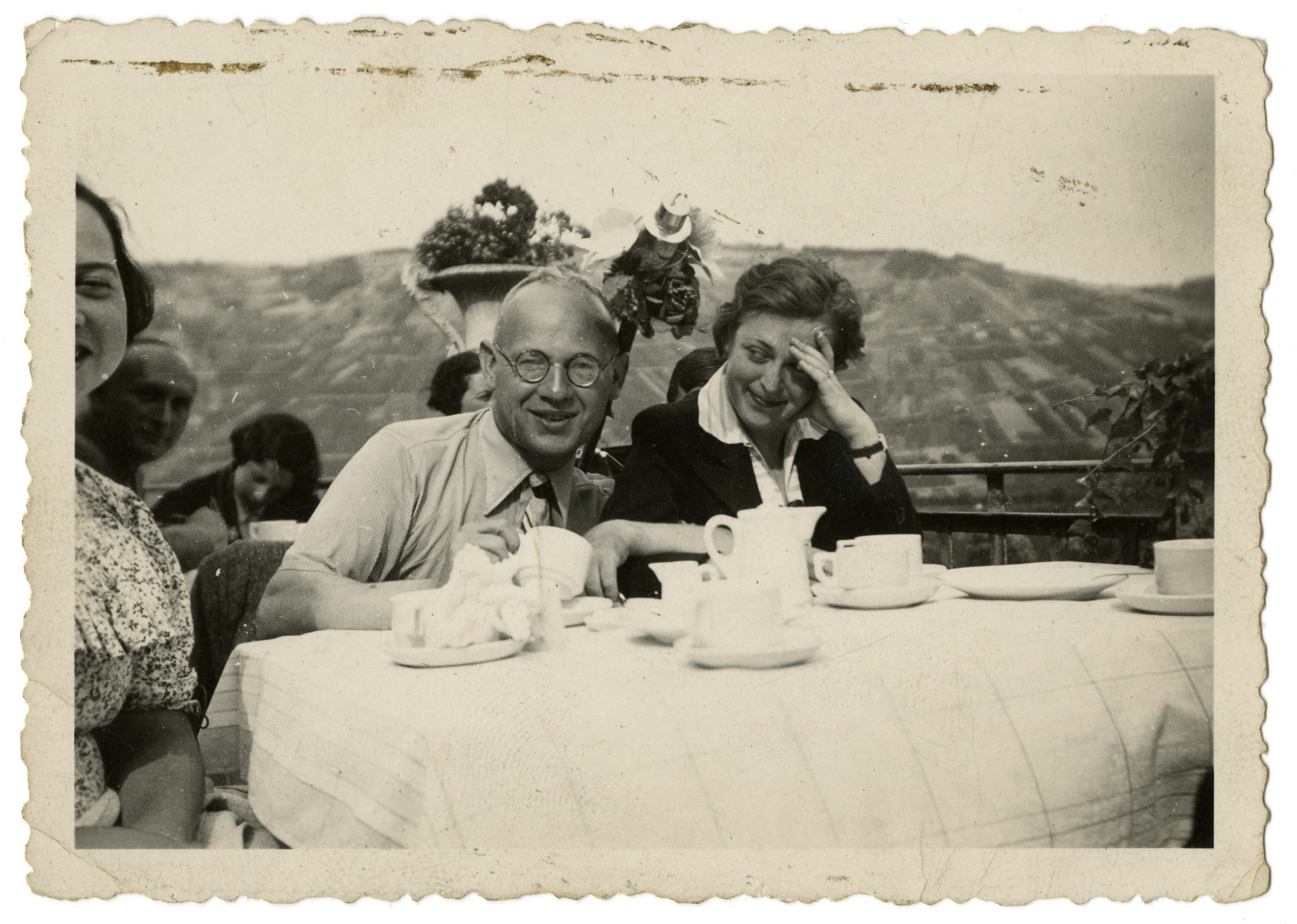 Sebald Mueller sits at a table with an unidentified family friend while vacationing in the mountains.