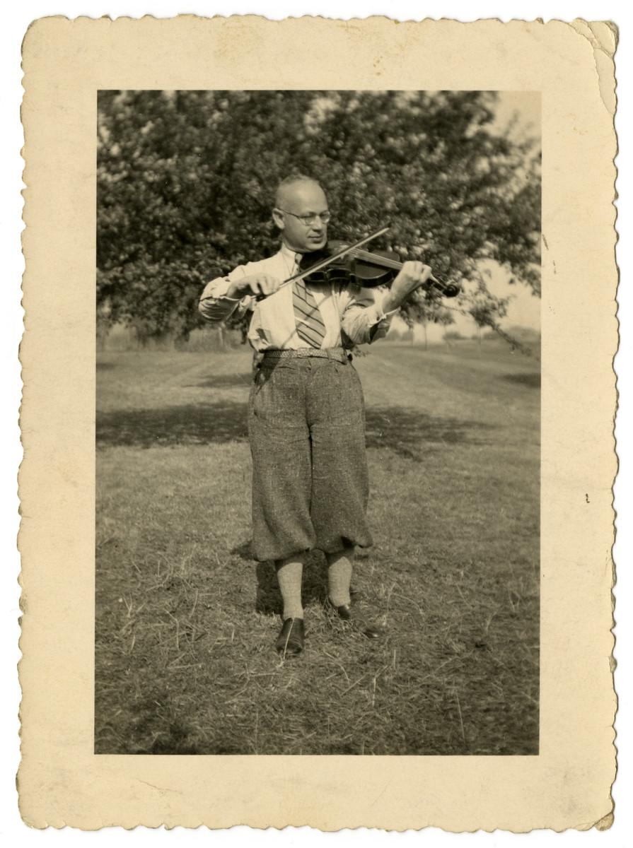 Sebald Mueller practices his violin.