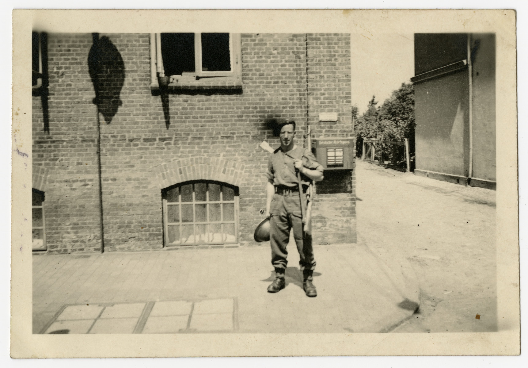 Norman Miller stands with his rifle and helmet while serving with the Royal Welsh Fusiliers.