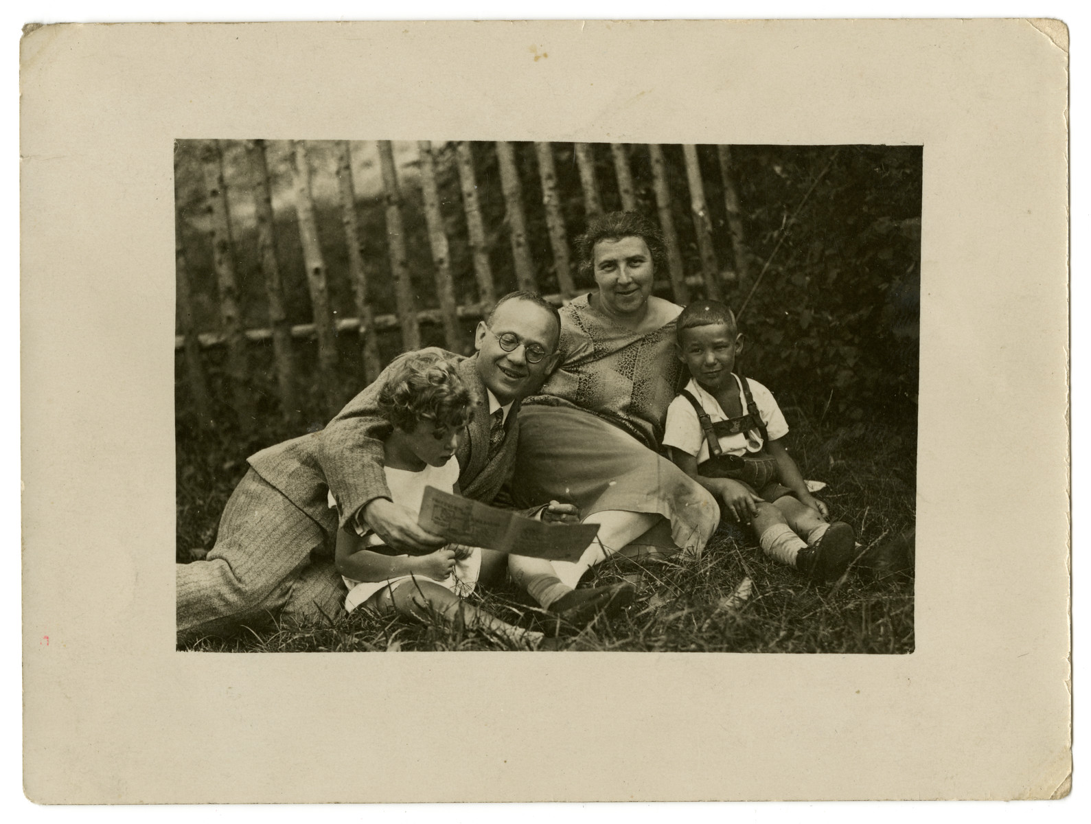 The Mueller family rests on the grass.  Left to right are Suse, Sebald, Laura and Norbert Mueller.