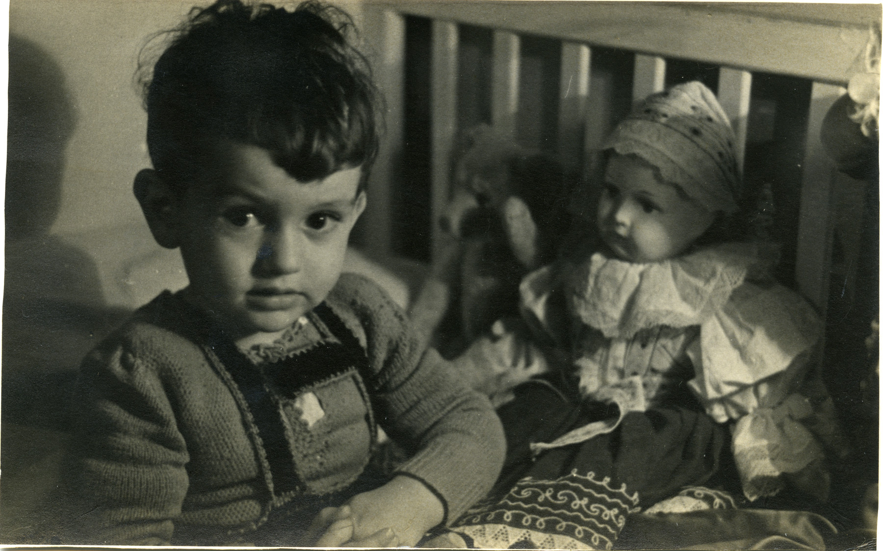 Villiam Krausz (Benjamin Kedar )sits surrounded by his toys shortly before the family went into hiding.