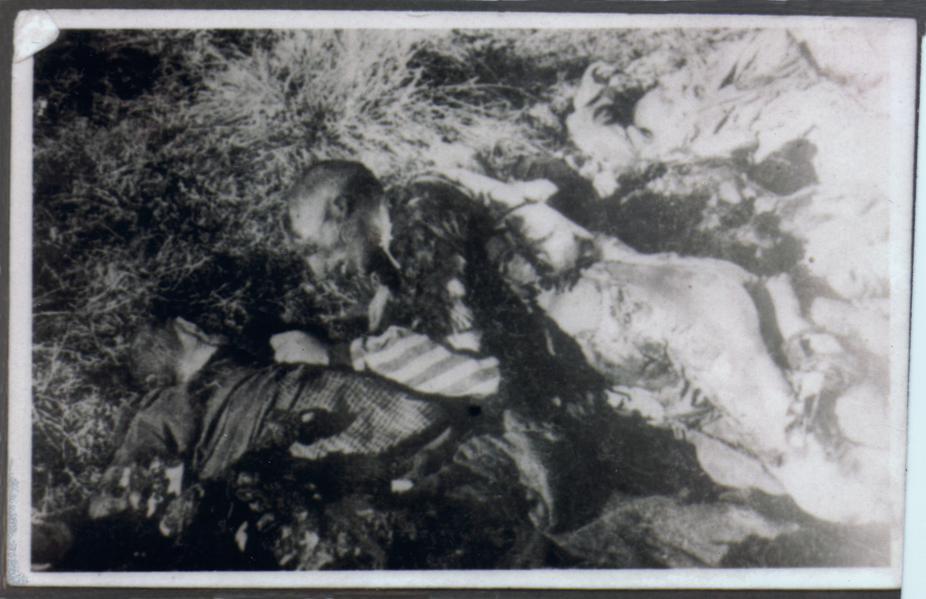 Two corpses lie on the ground of the Klooga camp following liberation.