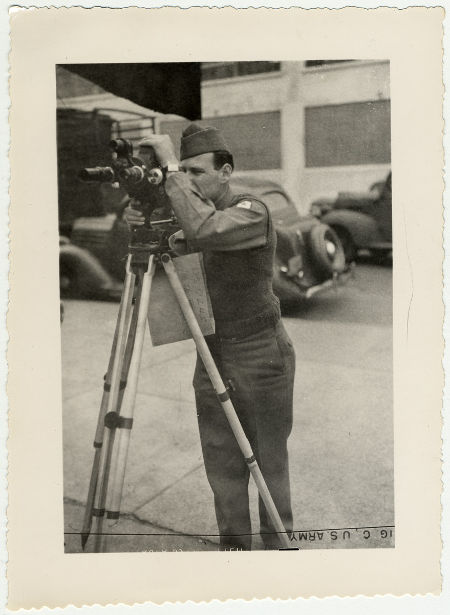 Portait of American Jewish signal corps photographer Paul Enfield with his movie camera.
