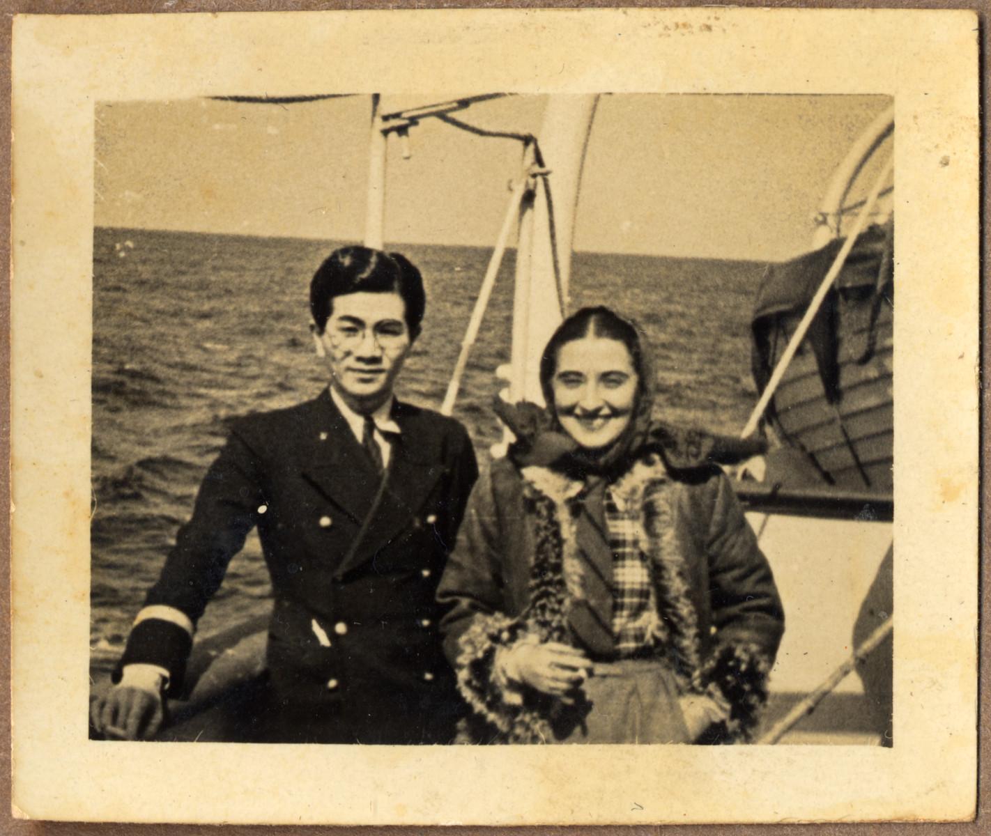 Tatsuo Osako's poses on board the Amakusa-maru with a female Jewish refugee.