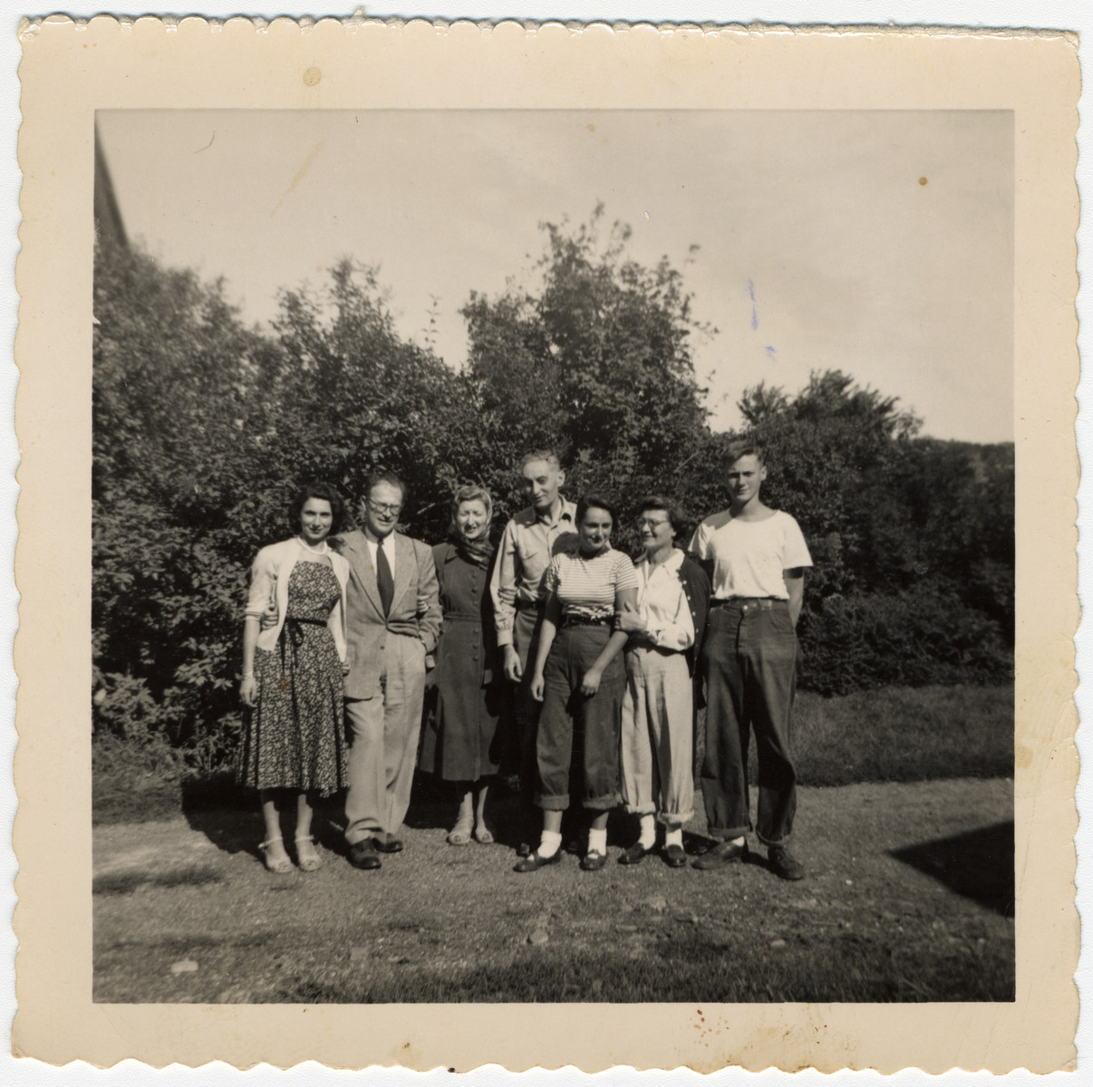 The Engel family poses on their farm in upstate New York.  Ludwig Engel is standing in the center.  To his right are his daughter Katie, wife Greta and son Adi.