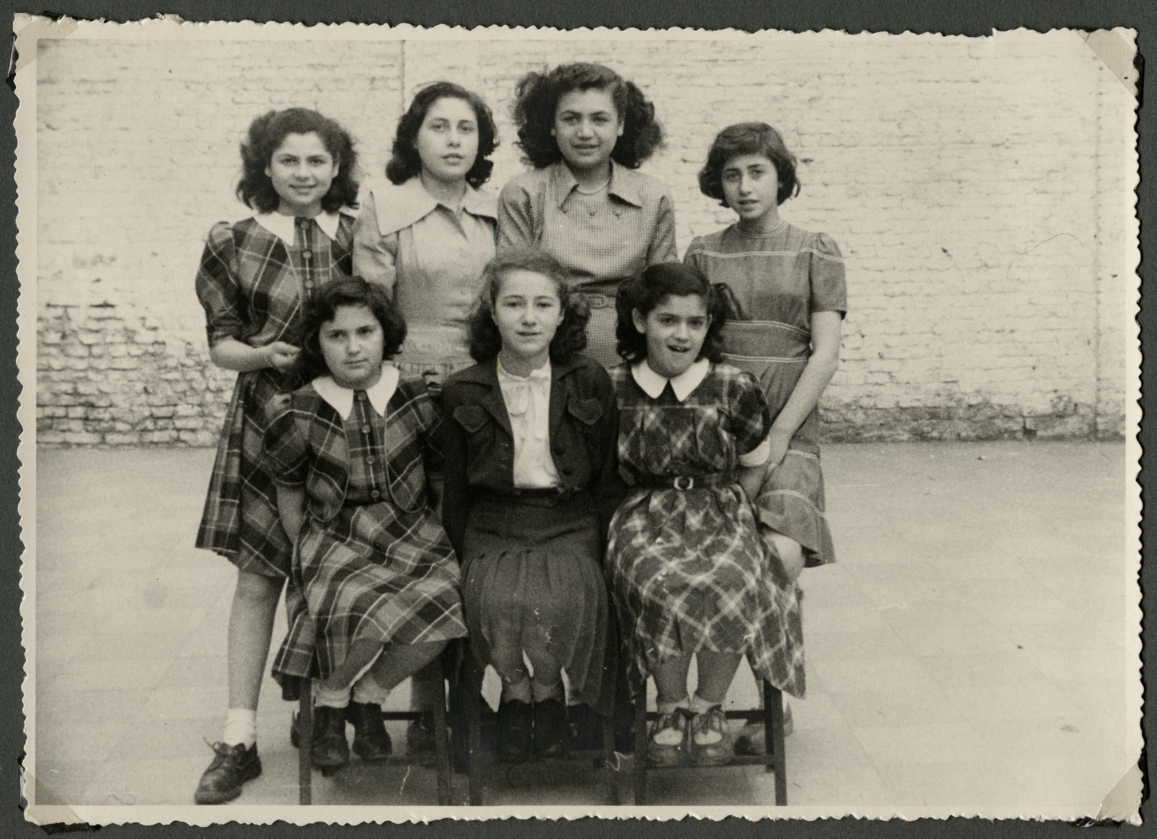 Group portrait of girls in the postwarTiefenbrunner children's home in Antwerp.  Standing second from the left is Augusta Wolf.  Standing on the right is Bertha