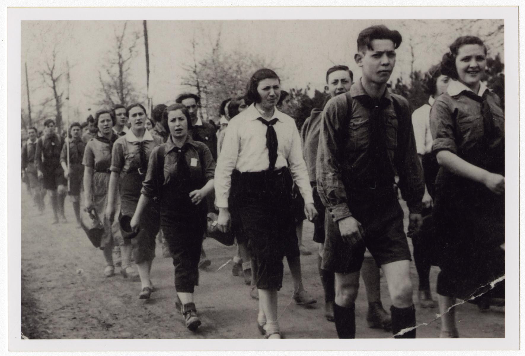 Members of Hashomer Hadati march down a path in or near Dabrowa.