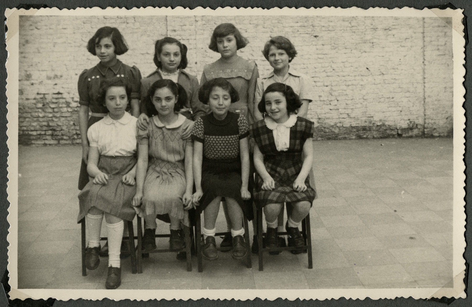 Group portrait of girls in the postwarTiefenbrunner children's home in Antwerp.  Pictured seated are Juliette (left) and Eva Goldman (second from left).  Standing left to right are Rutka Slonska, Renee Goldman, Marion Meyer and Sarah Cohen.