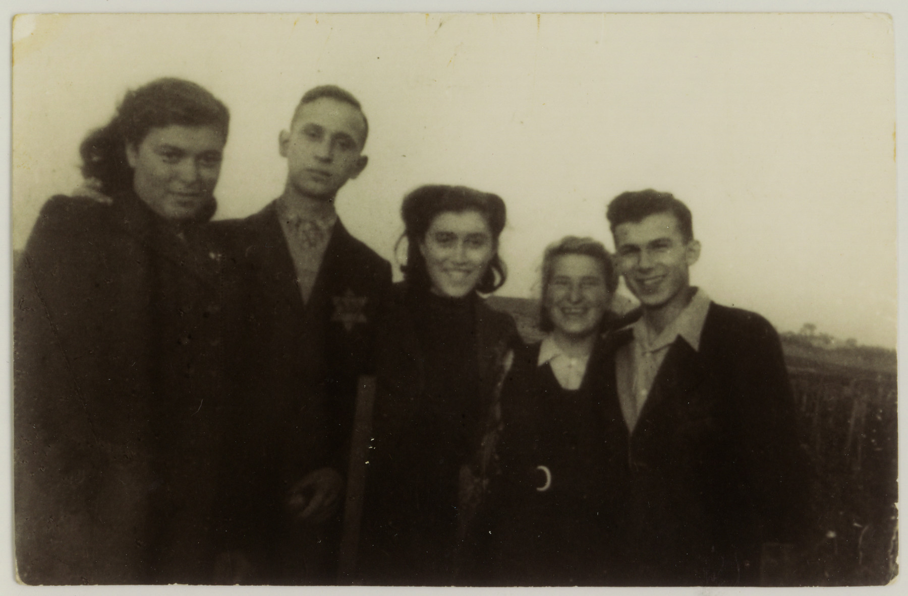 Portrait of five Jewish youth in the Dabrowa ghetto.