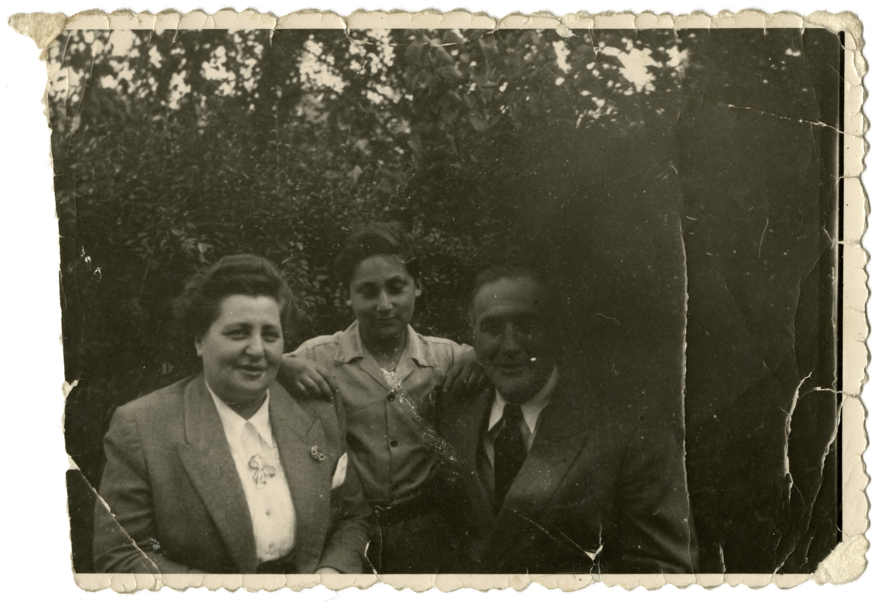 Simon Steil poses with the Mr. and Mrs. Finel, cousins of his mother who had escaped to Switzerland and spent the war there.