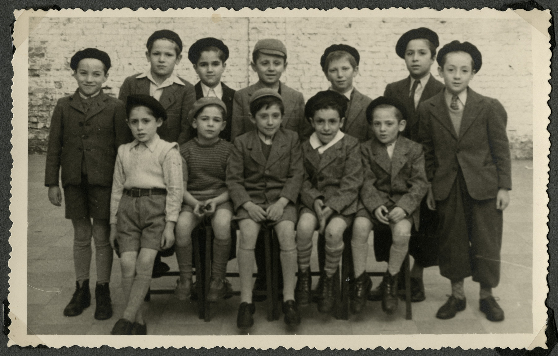 Group portrait of younger boys in the postwar Tiefenbrunner children's home in Antwerp.  Andre Sharp is standing on the far right.