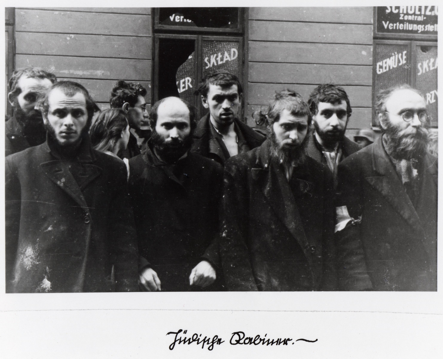 "Religious Jews captured by the SS during the Warsaw ghetto uprising.  The original German caption reads: ""Jewish rabbis."""