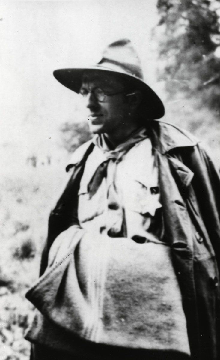 Close-up portrait of Leo Cohn carrying a blanket and wearing his Eclaireur Israelite uniform.
