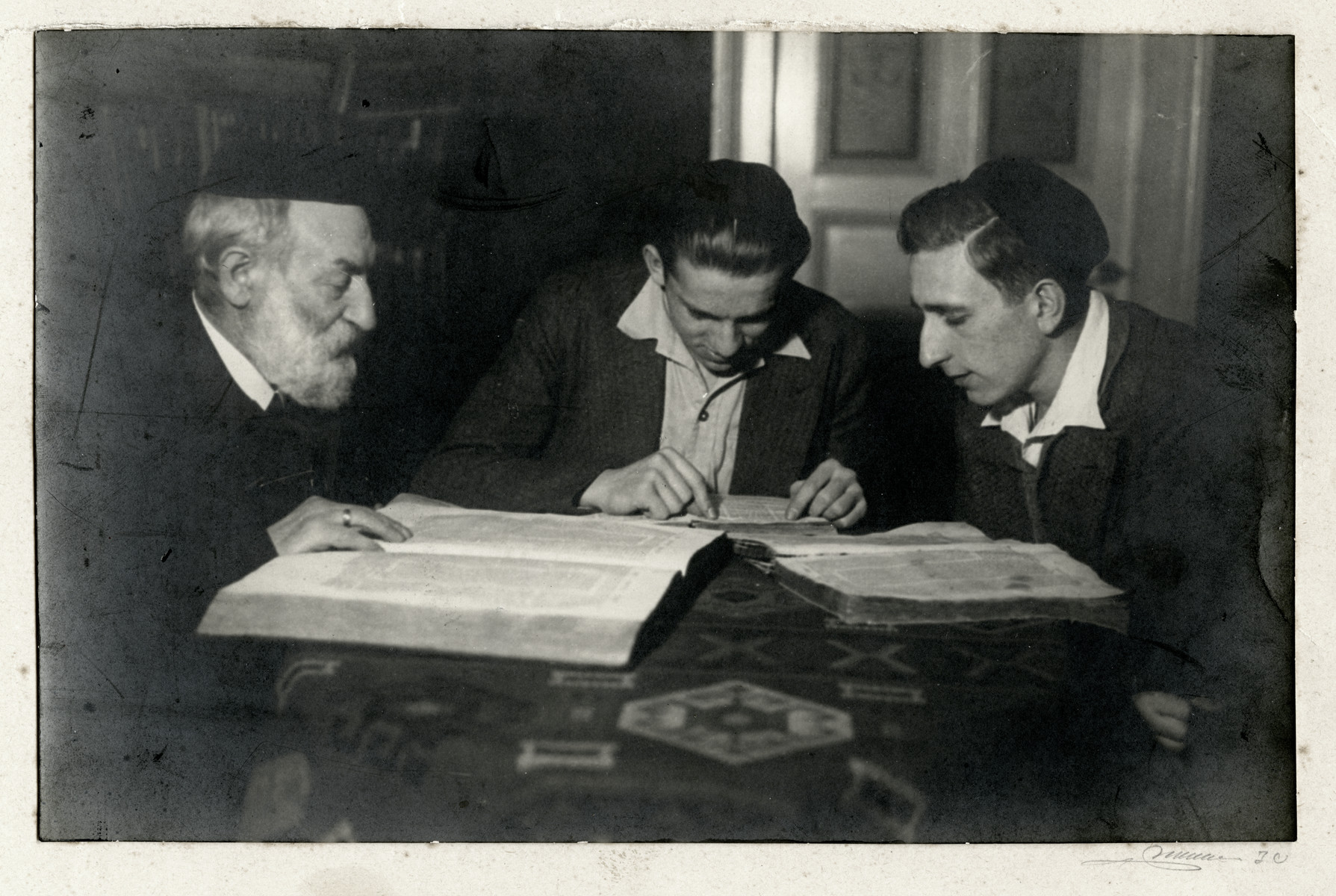 Josef Cohn and his grandsons Leo and Haim study the Gemorrah (Talmud).