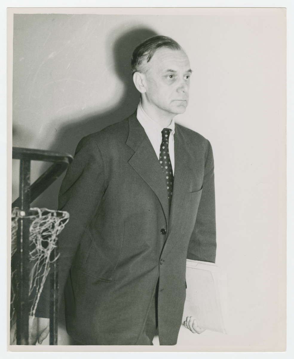 Alfred Rosenberg carries documents outside the coutroom during the Nuremberg trials.