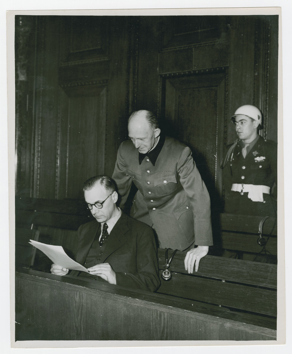 Alfred Rosenberg reads a statement while Alfred Jodl stands behind during the Nuremberg trials.