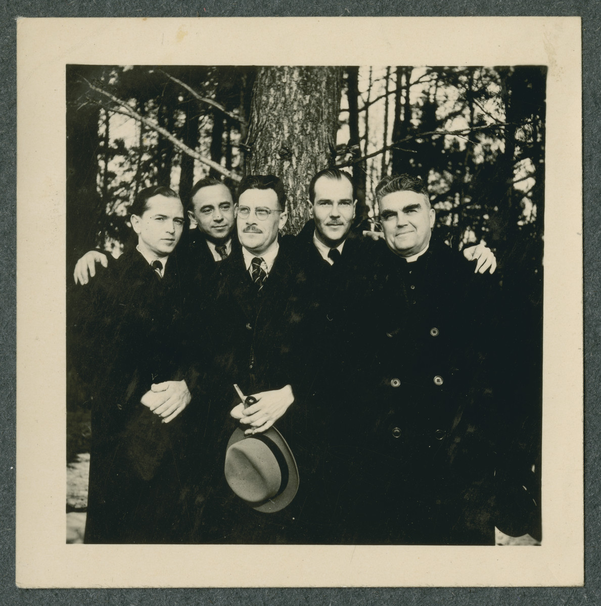 Group portrait of prisoners in the Tittmoning camp.  Father Sledz is pictured on the right.