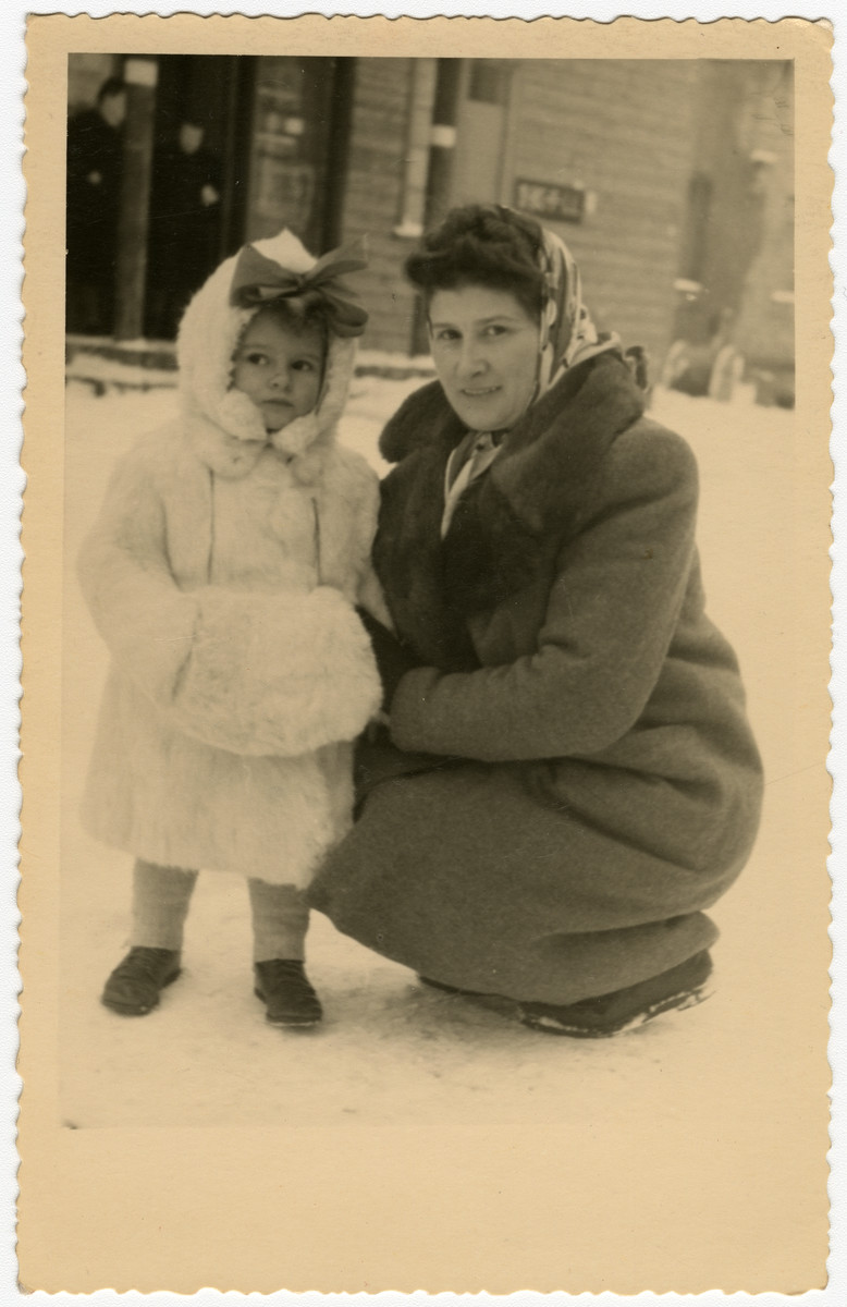 Mania and Frieda Kerschenblat pose on a snowy street of the Schlachtensee displaced persons camp.