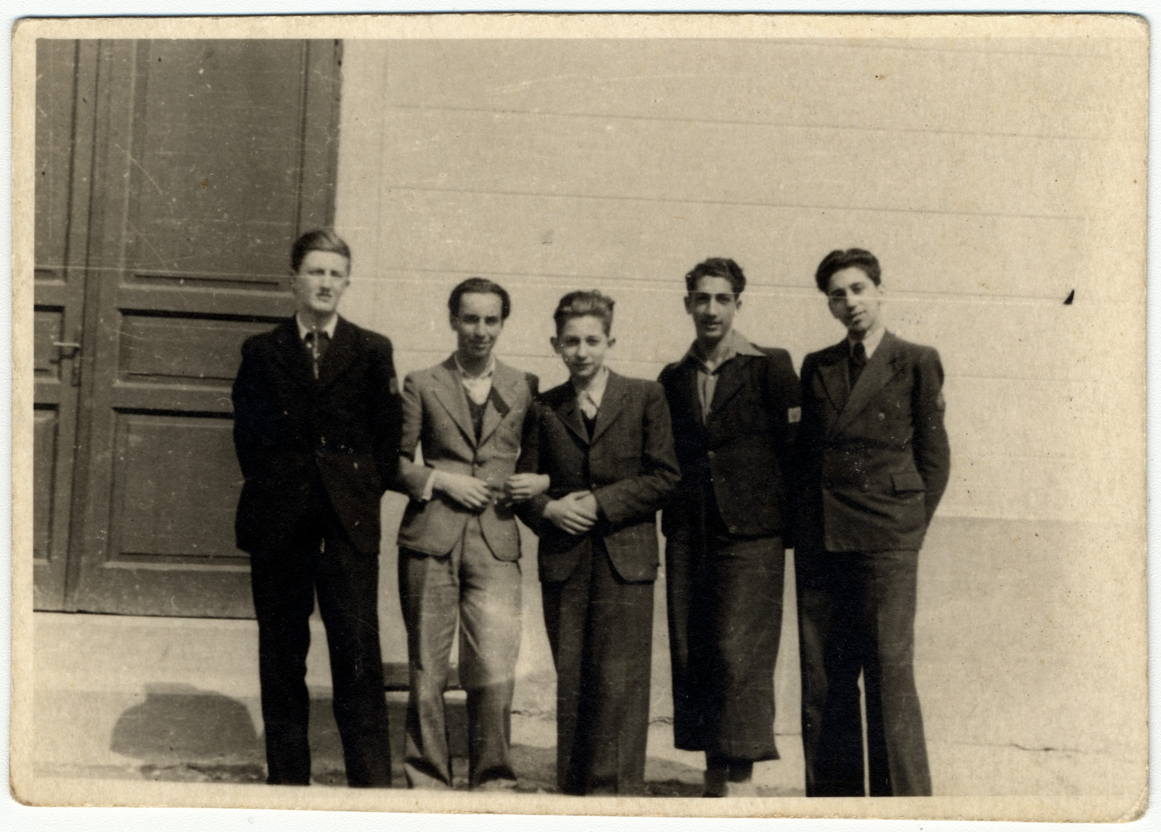 Portrait of five high school boys during the war in Brasov.  All were classmates of the donor who had already been expelled for being Jewish.  On the far left is Victor Stanculescu (he later became Romania's Minister of Defence and ordered the execution of Ceausescu.)  On the right is Mircea  Cristescu (he later became the conductor of the Romanian symphony).