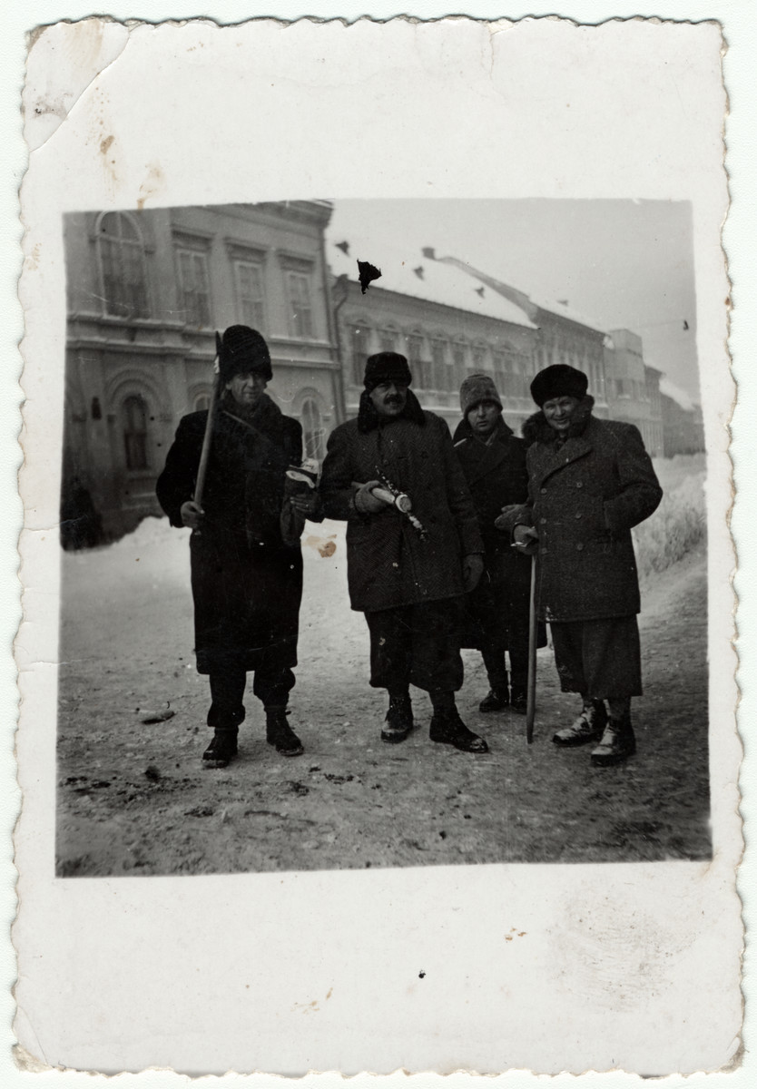 Romanian Jews are forced to clear snow during the winter of 1942 in Brasov, Romania.  Marcell Joszef is pictured on the far left.