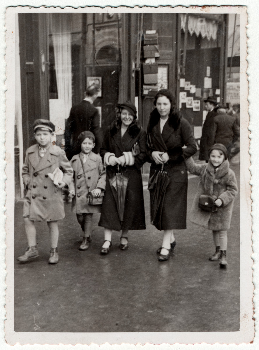 A German nanny goes for a walk with the two Jewish boys she cares for together with another nanny.  The nanny, Emily Gober, later came to the assistance of the Jewish community when antisemitic hooligans tried to attack them.  Pictured from left to right are Andrei and Gyorge Joszef, Emily Gober and her Christian friend.