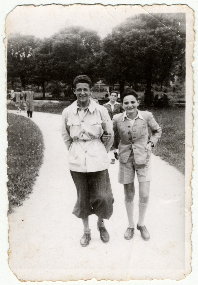 Two Jewish friends walk down a path in a park in Fascist Romania.  On the left is the donor Gyorge Joszef.  On the right is Gyorge Hollos (he survived and became an atomic physicist in Israel.)