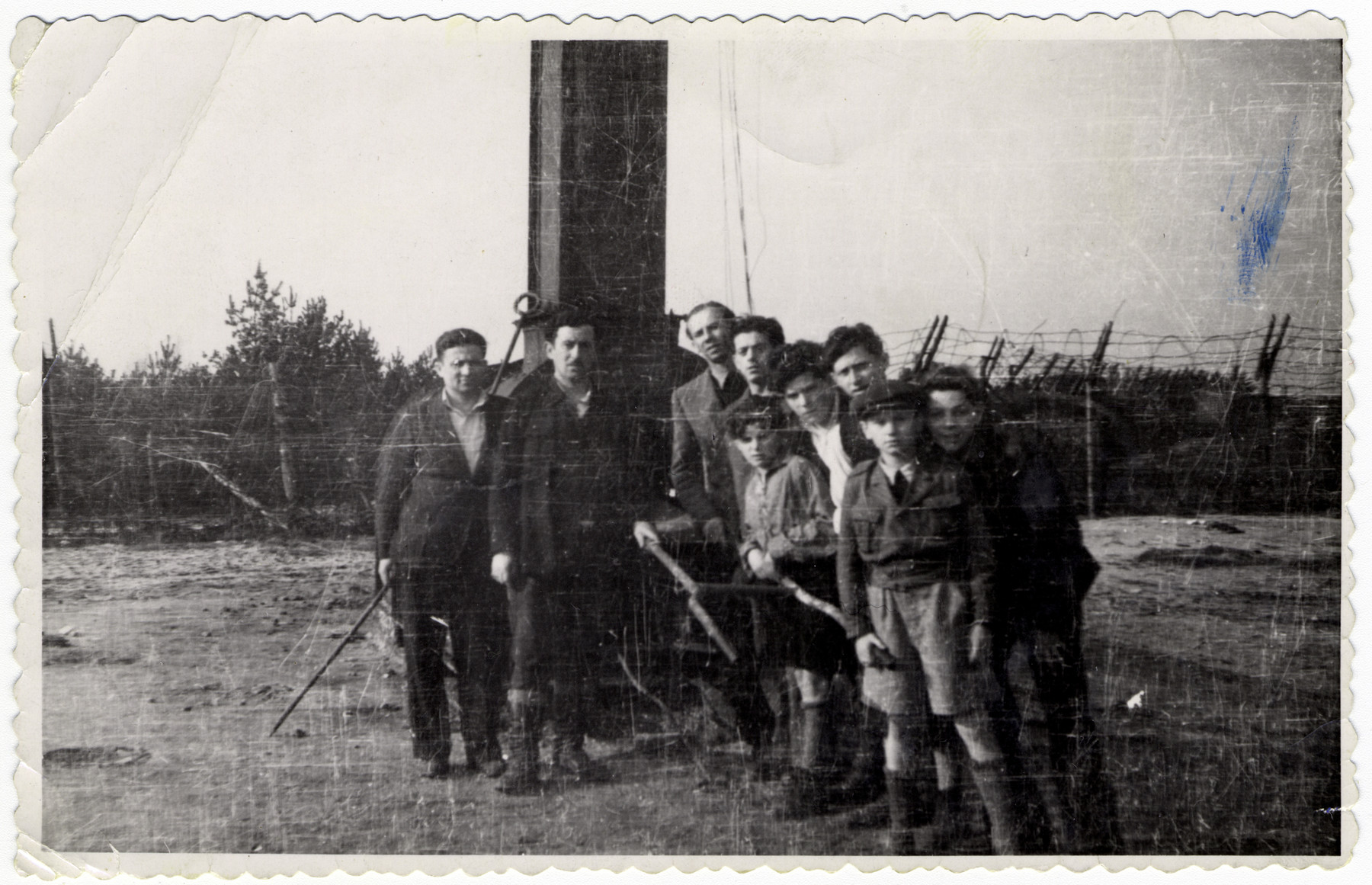 Teenagers from the Blankenesee children's home visit the grounds of the former Bergen-Belsen concentration camp.  George is kneeling on the far right.